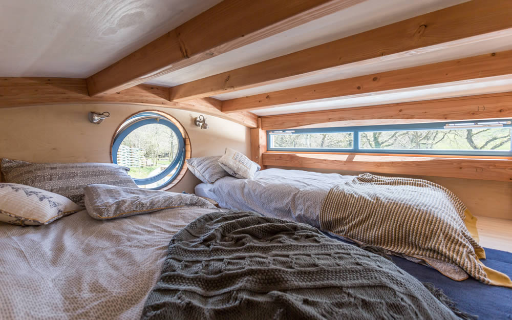 Interior of our timber cabin showing the mezzanine sleeping area