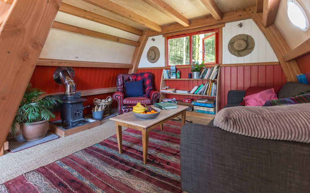 Interior of our timber cabin showing the living area