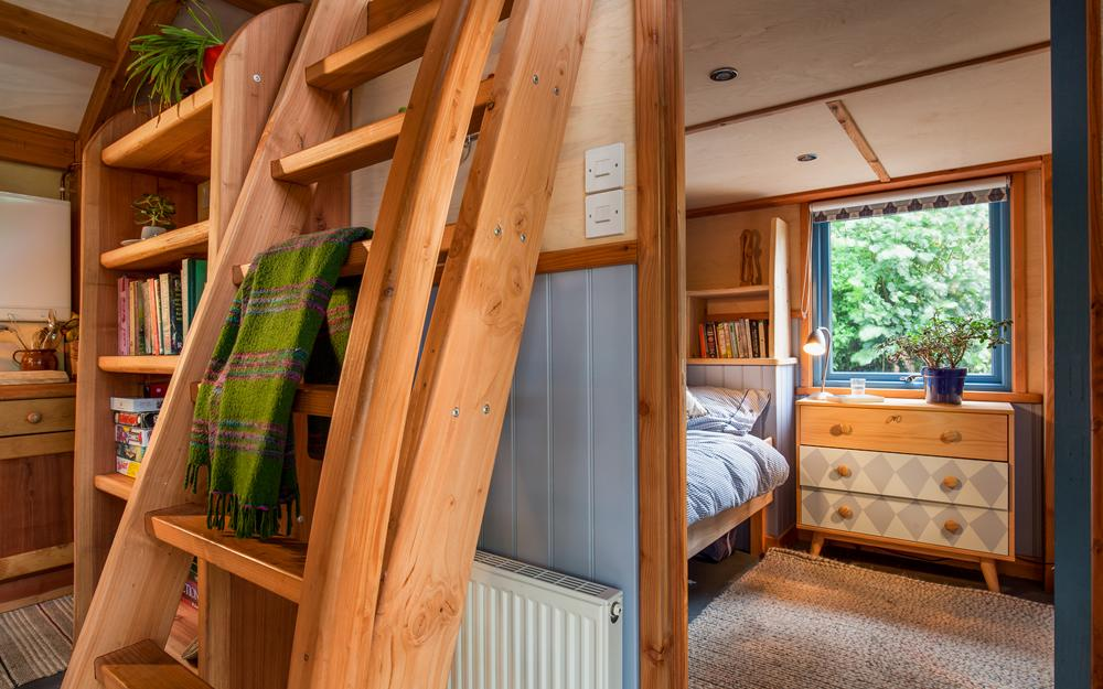 Interior of our timber cabin showing the bedroom area